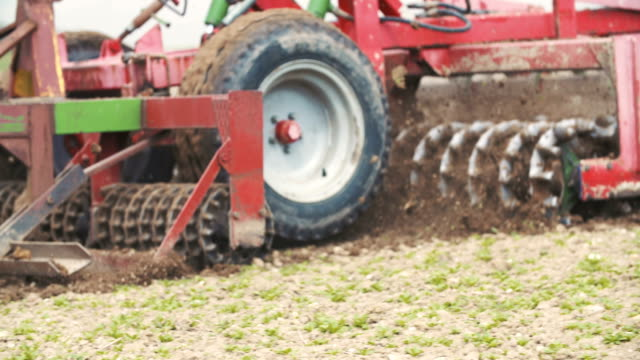 Farming background. Farmer working on field. video