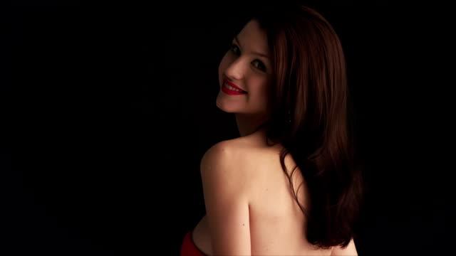 Fashion beauty unzipping red dress. video