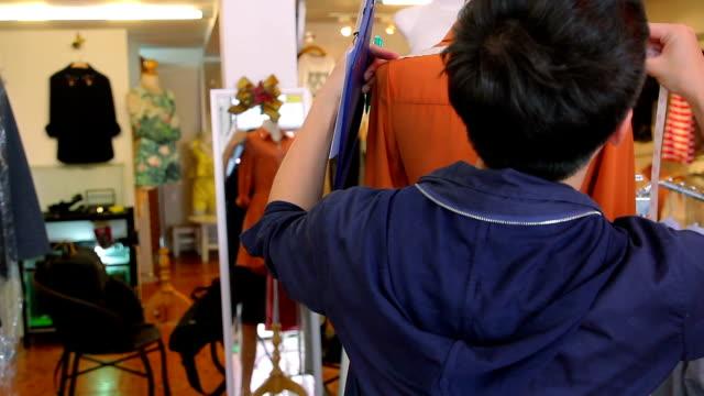Fashion Designer adjusting clothes on a mannequin video