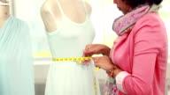 Fashion designer measuring dummy waist video