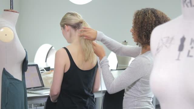 Fashion Designer measuring model in studio video