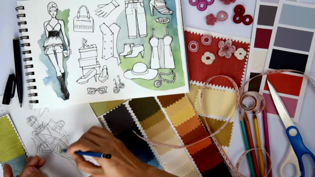Fashion designer & Tailor drawing and working with sketch of clothes, samples/ garment business concept video