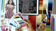 Fashion designer & Tailor working with sketch of clothes, tablet, samples/ garment business concept video
