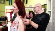 HD: Fashion Designer Taking Measurements video