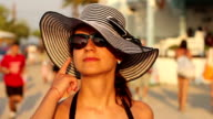 fashion style portrait of young trendy girl in fashionable hat and sunglasses video