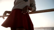 Fashionable Afro teen hipster girl leaning on railing at beach video