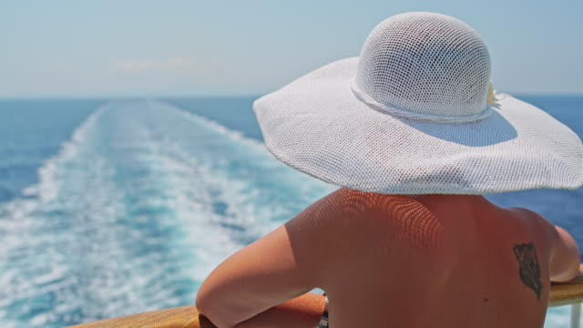 Fashionable woman enjoying a view on the cruise ship video
