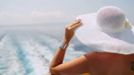Fashionable woman with white sun hat on the ferry video