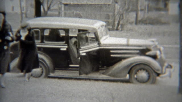 1938: Fashionable women arrive by car to the private party. video