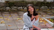 Fashioned girl siting on the street. video