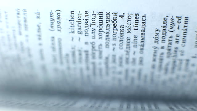 Fast flipping pages of thick book close up video