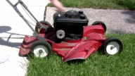 Fast Forward pull starting a lawn mower video