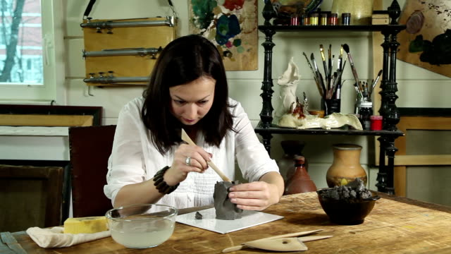 Fast motion video of modeling a clay sculpture video