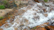 Fast river and waterfall on orange rocks video