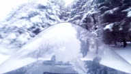 Fast Snowmobile Driver and Windshield Reflection video