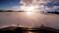 Fast Snowmobile Footage during Sunset in Powder Snow. video