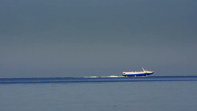 Fast speed boat fly on sea surface waves at dark weather. HD 1080p. video