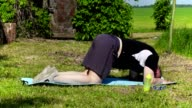 Fat man stretches at outdoor after workout video