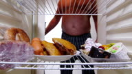 Fat man takes out food from the fridge video