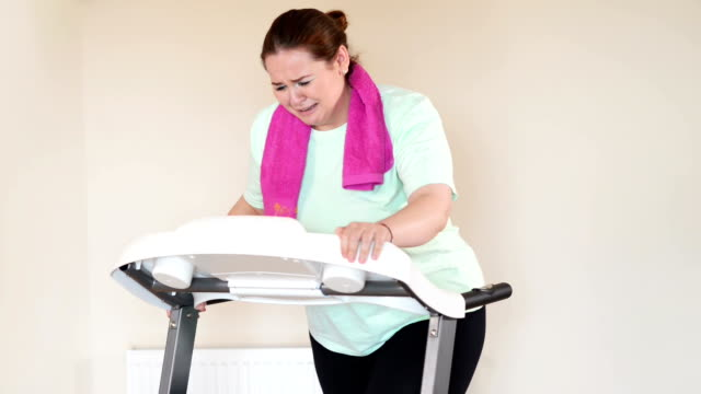 Fat woman running treadmill video