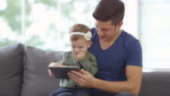 Father and Baby Girl using a Digital Tablet video