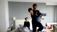 Father and children having fun in the morning video