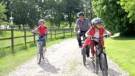 Father And Children On Cycle Ride In Countryside video