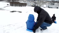 Father and Children Sledding video