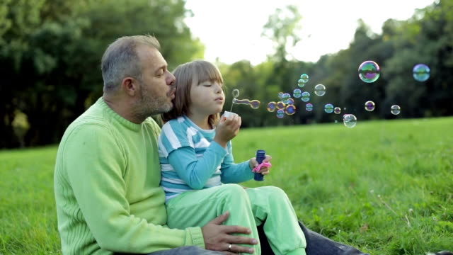 Father and Daughter are playing in nature video