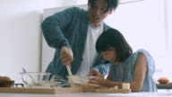 Father and daughter baking together video