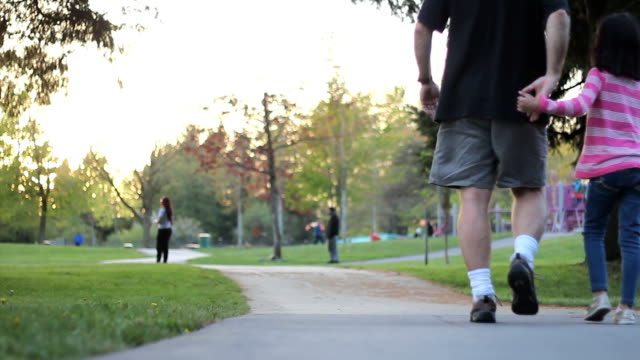 Father And Daughter Enjoy Walk At The Park video