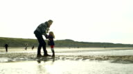 WS Father and daughter enjoying on beach video