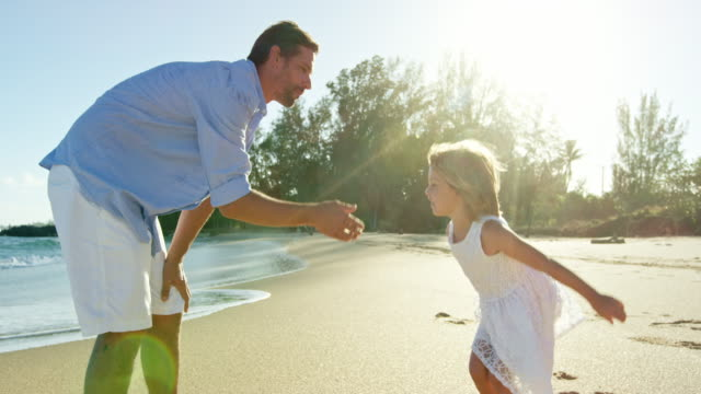 Father and Daughter Having Fun on the Beach video
