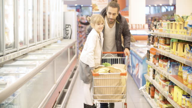 Father and Daughter In Shopping video