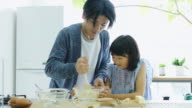 Father and Daughter Making Cake in Sunlit Japanese Kitchen video