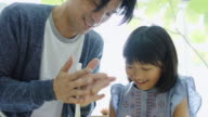 Father and Daughter Making Cake Together in Japanese Home Kitchen video