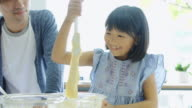 Father and Daughter Mixing Cake Together video