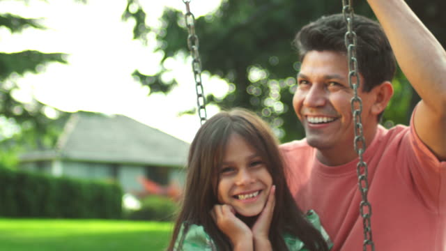 Father and daughter on a swing video