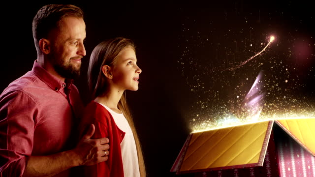 Father and daughter opening magical gift video
