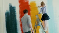 Father and Daughter Painting the Wall video