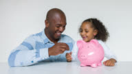 Father and daughter saving money for her education video
