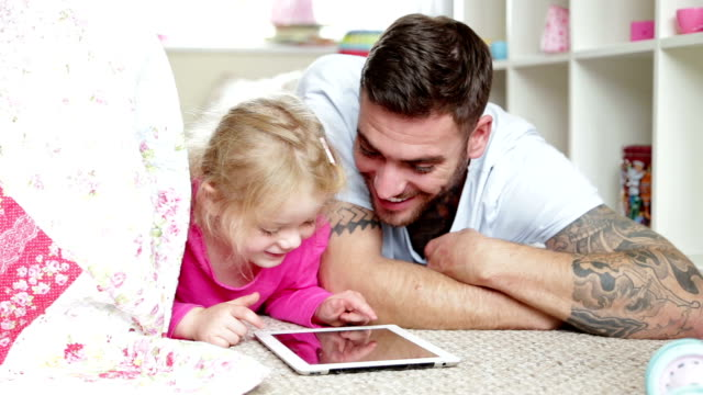 Father and Daughter using Digital Tablet video