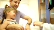 Father and his dauhter at the doctor pediatrician video