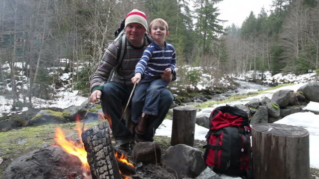 Father and son by campfire video