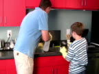 Father and Son Cleaning Together video