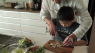 Father and son cutting the mushroom video