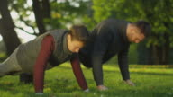 Father and Son Doing Push-ups in the Park. video