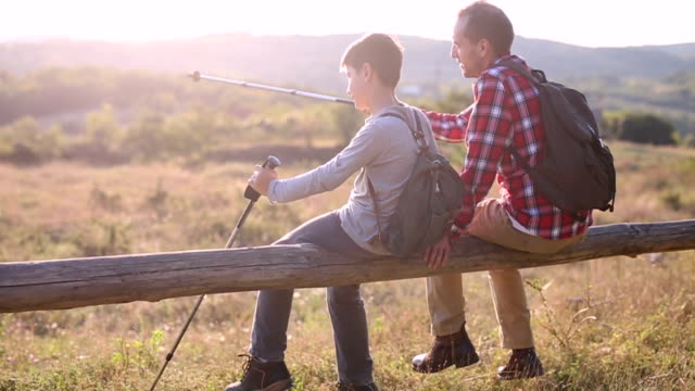 Father and son enjoying outdoors video