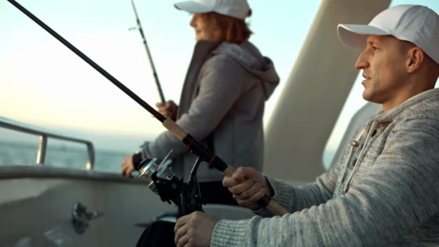 HD: Father And Son Fishing From The Stern video