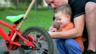 Father and son fixing bicycle tire video